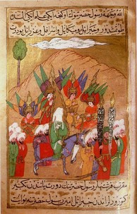 A depiction of Muhammad (with veiled face) advancing on Mecca from Siyer-i Nebi, a 16th-century Ottoman manuscript. The angels Gabriel, Michael, Israfil and Azrail, are also shown.