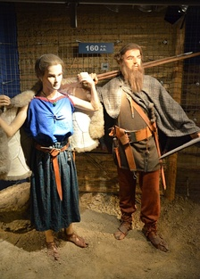 "Reconstruction of the garments of the Vandalic couple, with the male having his hair in a ""Suebian knot"" (160 AD), Archaeological Museum of Kraków, Poland."