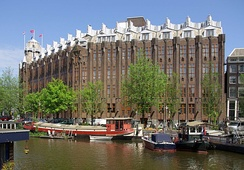 The Scheepvaarthuis, by architects Johan van der Mey, Michel de Klerk, Piet Kramer is characteristic of the architecture of the Amsterdam School