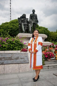 A doctoral graduate (PhD) of Chulalongkorn University in Thailand, dressed in an academic gown for her graduation ceremony.