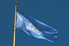 The Flag of the United Nations flying at United Nations Plaza in the Civic Center, San Francisco, California. The UN is one of the key organizations in the process of the political globalization