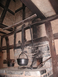 Hearth with cooking utensils