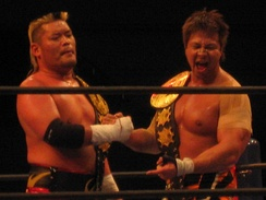 Tenzan (left) and Satoshi Kojima as the IWGP Tag Team Champions in February 2012.