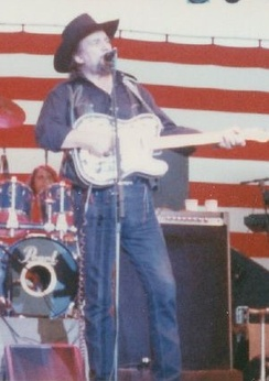 Waylon Jennings in concert, playing his custom 1953 Fender Telecaster
