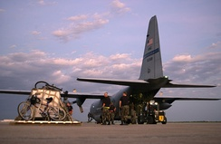 Air Force crews offload cargo as the remnants of Hurricane Rita drift away in 2005