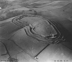 Maiden Castle in 1935. The Iron Age hillfort was first built in 600 BC.