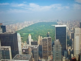 Central Park, the most visited urban park in the United States and one of the world's most visited tourist attractions,[1] is surrounded by the skyscrapers of Manhattan in New York City.