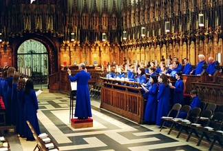 Evensong rehearsal in the quire of York Minster, showing carved choirstalls