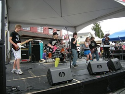 Students from the Paul Green School of Rock Music performing at the 2009 Fremont Fair, Seattle, Washington.