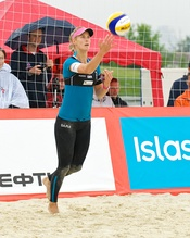 A beach volleyball player in leggings