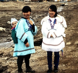 People in cold climates tend to be lighter skinned such as these Inuit women from Canada.
