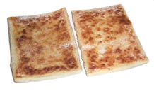 Potato bread (top) and soda farl (bottom) are included in the Ulster fry.
