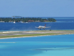Plane landing on an airport island, Velana International Airport, Hulhulé Island, Maldives