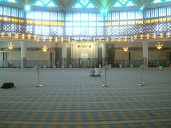 Interior of the national mosque of Malaysia. Neither Mormons nor Muslims permit drawings or photos inside their places of worship; the Mormons do allow some in the hallways and elsewhere outside of their chapels.
