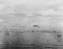 IJN aviators pressed home a torpedo attack against American ships off Guadalcanal on 8 August 1942, suffering heavy losses. The plane on the left and at extreme low-level (approximately five meters) was flown by Jun Takahashi, who was still alive in 2016.