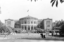 Norwegian parliament building in 1941 under German occupation, with the swastika flag and the German V sign on the front of the building