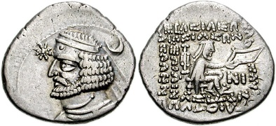 A star and a crescent appearing (separately) on the obverse side of a coin of Orodes II of Parthia (r. 57–37 BCE).