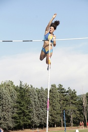 Anna Giordano Bruno releases the pole after clearing the bar
