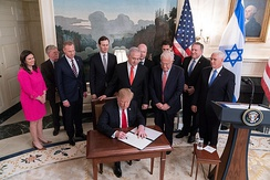 President Trump, joined by Pompeo and Netanyahu behind, signs the proclamation recognizing Israel's 1981 annexation of the Golan Heights, March 25, 2019.