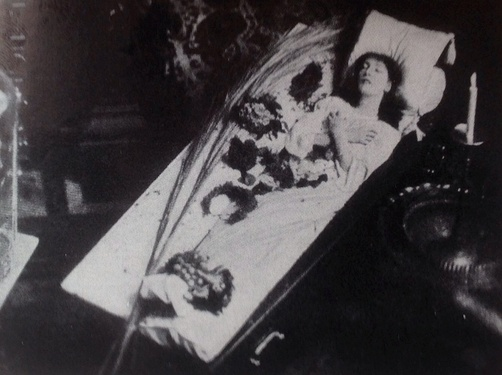 Bernhardt in her famous coffin, in which she sometimes slept or studied her roles (c. 1873)
