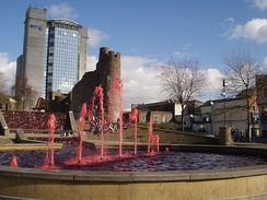 Red fountain water during the celebration of St David's Day in Swansea