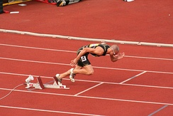 Jeremy Wariner beginning a race from the starting blocks