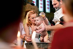 Christening photograph showing the oil moment and Baptism in Greek Orthodox Church.