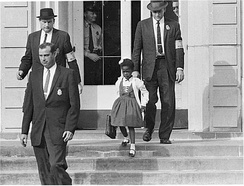 Due to threats and violence against her U.S. Marshals escorted 6-year-old Ruby Bridges to and from the previously whites only William Frantz Elementary School in New Orleans, 1960. As soon as Bridges entered the school, white parents pulled their children out.