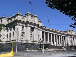 The Victorian Parliament House, built in 1856, stands in Spring Street, Melbourne. The building was intended to be finished with a dome, but was not completed due to budget constraints.