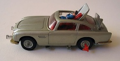 a silver-coloured toy car showing a plastic man being ejected through the roof.