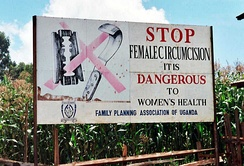 Campaign sign against female genital mutilation that reads:Stop Female Circumcision It is Dangerous to Women's Health