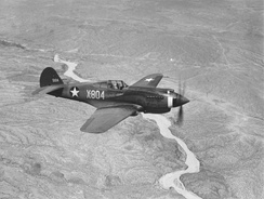 A three-quarter view of a P-40B, X-804 (s/n 39-184) in flight. This aircraft served with an advanced training unit at Luke Field, Arizona.