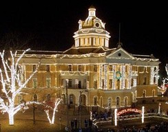 The Old Harrison County Courthouse in Marshall, Texas outlined in Christmas lights