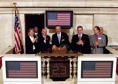 U.S. Secretary of Commerce Donald L. Evans rings the 'opening bell' at the NYSE on April 23, 2003. Former chairman Jack Womack is also in this picture.