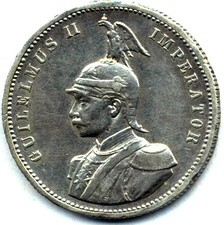 German East African Roupie, 1890.  Coins of European Colonial Empires were sometimes inscribed in Latin, such as this colonial coin featuring Wilhelm II of Germany.