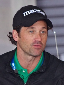 Patrick Dempsey wearing a cap looking away from the camera