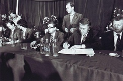 The signing of an agreement between leaders of striking workers and government representatives in Szczecin in August 1980