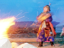 Shaman holding a séance by fire. Settlement Kyzyl, region Tuva, Russia