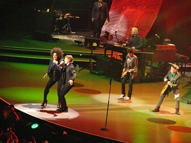 Fischer singing with Jagger and The Rolling Stones during their Fifty and Counting Tour, in Boston Mass., June 12, 2013