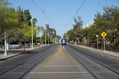 2nd Street with a Sun Link streetcar in the background