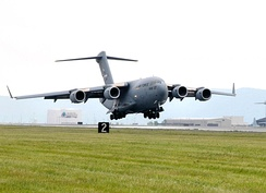 The first C-17 assigned to the 105th Airlift Wing lands at the base on 18 July 2011.