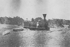 "The locomotive ""Ballarat"" in the sand at Wonnerup, 1921. Reputed to be the oldest in Western Australia, the engine now sits in St Marys Park, Busselton."