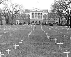 "Bascom Hill, 1968, with crosses placed by students protesting the Vietnam War, and sign reading, ""Bascom Memorial Cemetery, Class of 1968"""