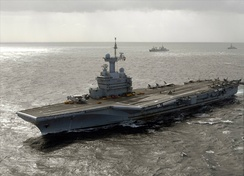 In 1999 the French carrier Charles De Gaulle began her sea trial phase, which identified the need for the flight deck to be extended for the safe operation of the E2C Hawkeye.