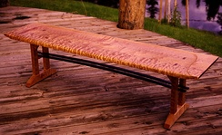 A bench made of highly figured maple wood