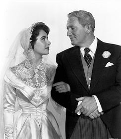 Tracy and Elizabeth Taylor in a promotional image for Father of the Bride (1950). The comedic role of Stanley Banks was one of Tracy's nine Oscar-nominated performances.