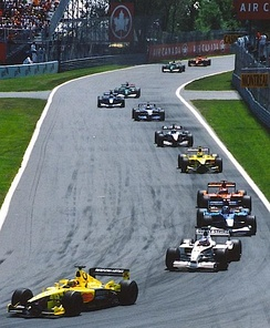 Trulli leads the midfield on the first lap of the 2001 Canadian Grand Prix.