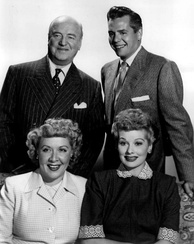 Cast members from left, standing: William Frawley, Desi Arnaz, seated: Vivian Vance and Lucille Ball.