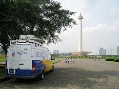 A Metro TV news van parked in Merdeka Square, Jakarta