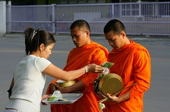 Monks receiving alms